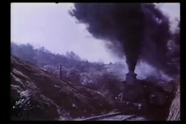 Explosion in front of locomotive traveling through mountains