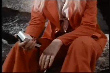 Woman holding transistor radio — Stock Video #26665073