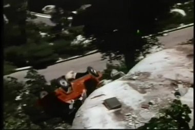Car falling off cliff and blowing up — Stock Video #26665119