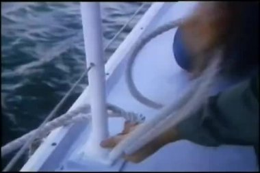 Hands tying rope to railing on ship — Stock Video #26665439