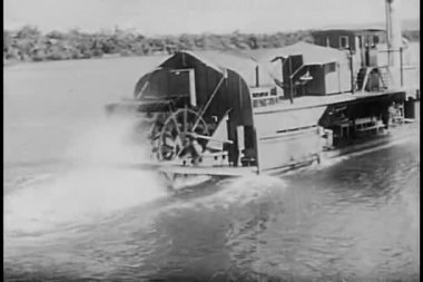 Rear view of steam boat traveling down river — Stock Video