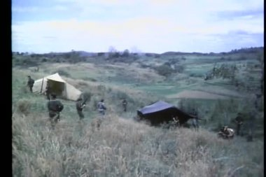 Soldiers patroling hillside Army camp — Stock Video