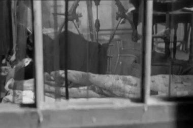 View through window of person sleeping on floor — Stock Video
