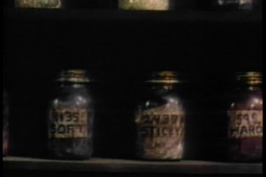 Close-up shelves with jars containing different types of oil — Stock Video