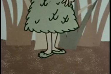 Pan up girl wearing matching dress, hat, and shoes made of leaves — Stock Video