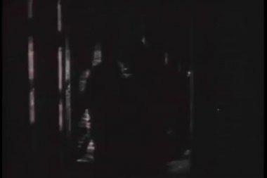 Man in gorilla suit walking down hallway — Stock video
