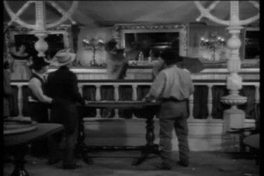 Wide shot of western bar room brawl — Stock Video