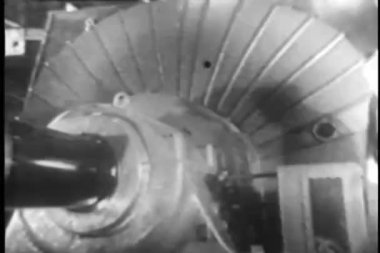 Man in wind tunnel inspecting electric motor — Vídeo Stock