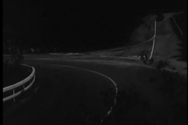 1940s car speeding down country road  to highway at night — Stock Video