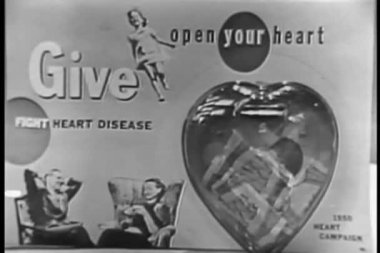 Woman placing money in plastic heart — Video Stock