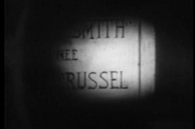 Flashlight shining on a tombstone — Stok video