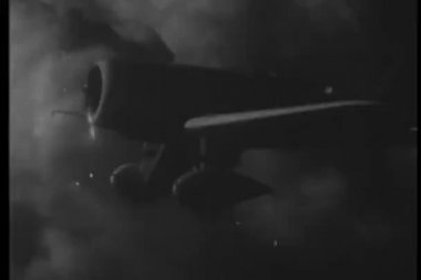 1930s airplane flying through the clouds — Стоковое видео