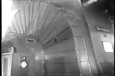 Man in wind tunnel walking by electic motor — Stock video