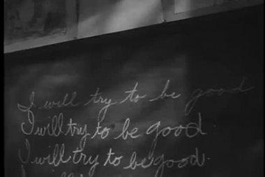 Repetitive sentences written on blackboard — Stock Video