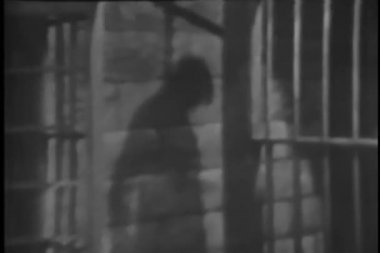 Shadow of hanged man on prison wall — Wideo stockowe