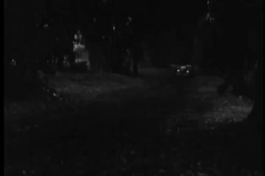 1940s car speeding down country road at night — 图库视频影像