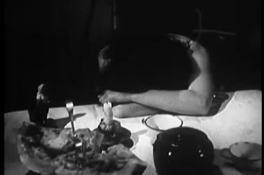 Upset woman with head down at table — Wideo stockowe