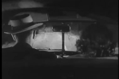 Man and woman in car driving in rain — Video Stock