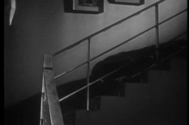 Man falling down flight of stairs clutching barware — Stock Video