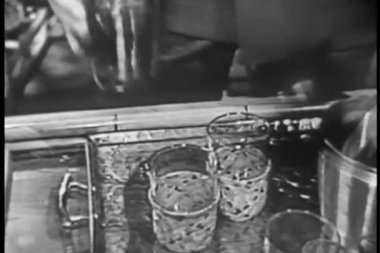 Man pouring beverage into small glasses — Stok video