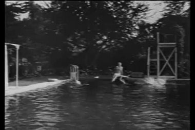 People swimming in outdoor swimming pool in the country — Stockvideo
