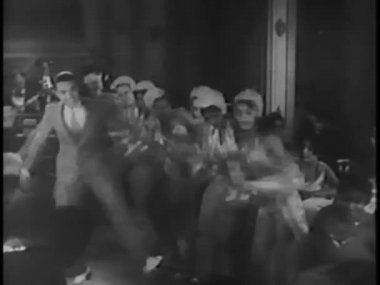 Male tap dancer joining female dancers in nightclub — Video Stock