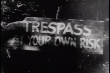 Trespass at your own risk sign — Стоковое видео