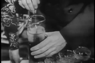 Man mixing beverage in pitcher — Stockvideo