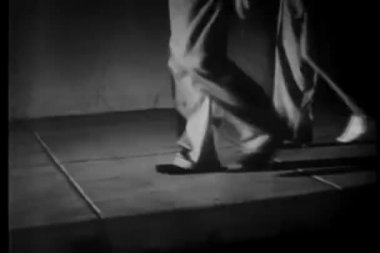 Group of people walking in stocking feet — Vídeo de stock