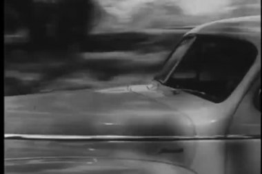 Vintage car driving down dirt road — Stockvideo
