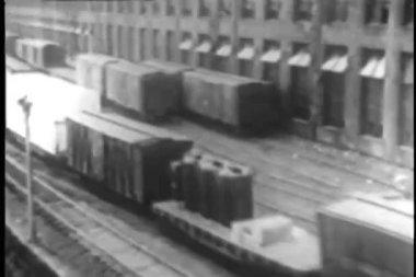 Freight train moving through freight yard — Stok video