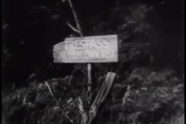 Trespass at your own risk sign — Vídeo de stock