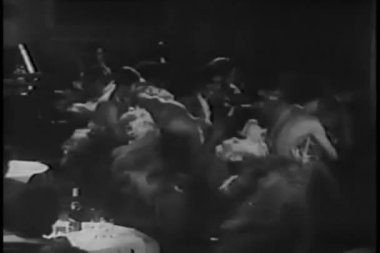 Dancers in feather costumes performing in nightclub — Wideo stockowe