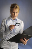 The woman with magnifying glass — Stock Photo