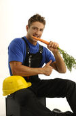 Young worker eating carrot — Stock Photo