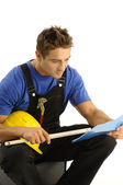 Young worker reading instructions — Stock Photo