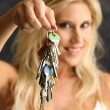 Blond woman with the key — Foto de Stock