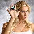 Blond woman with the key — Stock Photo #12568796