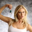 Blond woman with the key — Stock Photo #12568814