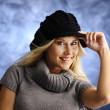 Blond girl in a black hat — Photo