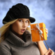 Blond girl with a gift — Stock Photo
