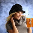 Blond girl with a gift - Stock Photo