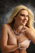 Woman covering her breasts — Foto Stock
