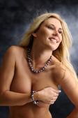 Woman covering her breasts — Stockfoto