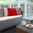 Stock Photo: Rattfurniture in conservatory