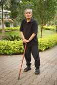 Old Asian man with walking stick — Stock Photo