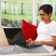 Woman using laptop - Stock Photo