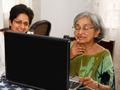 Elderly woman laptop — Stock Photo