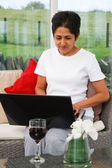 Indian woman using internet — Stock Photo