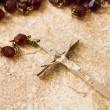 Rosary beads on stone — Stock Photo